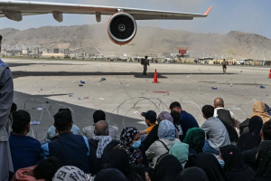 I'm a woman journalist who has lived in Afghanistan for eight years. Now I'm helping evacuate citizens, and the horror show I've witnessed will stay with me for life.