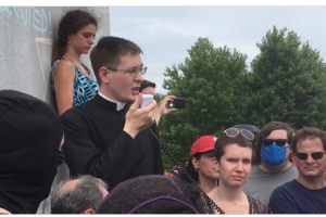 "Catholic priest among defenders of St Louis statue; Muslim Action Network ""take this thing down"""